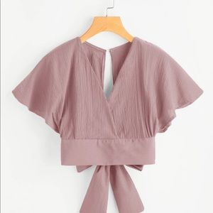 Pink backless crop top with bow